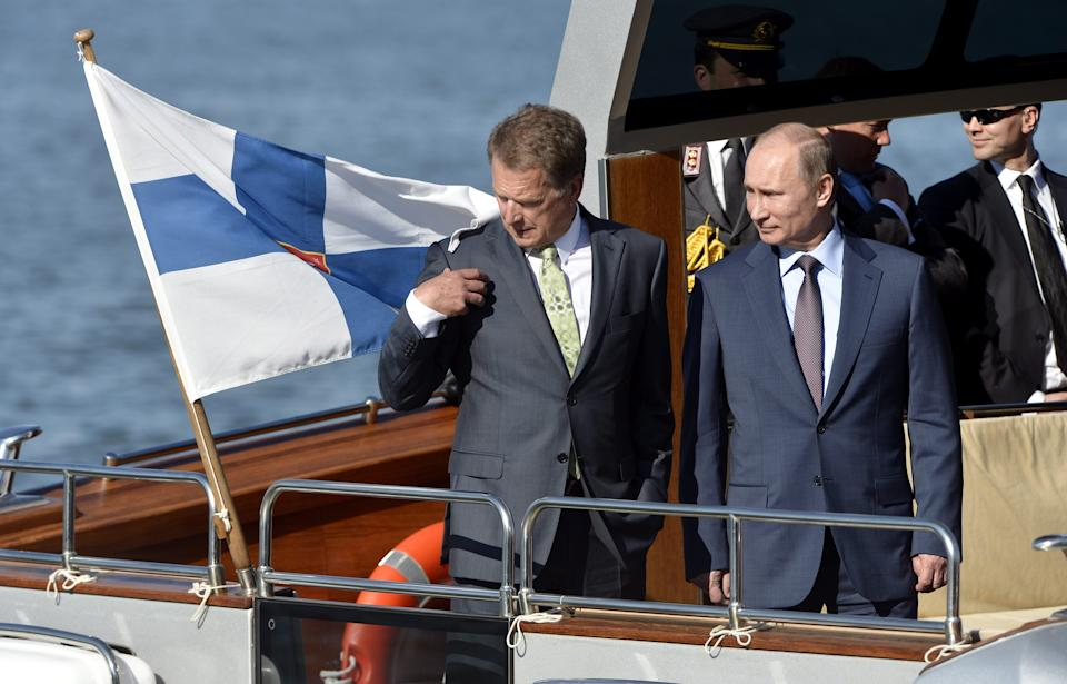 Finnish President Sauli Niinisto, left, and his Russian counterpart Vladimir Putin pictured on the Kultaranta VIII boat as they leave the presidential summer residence Kultaranta in Naantali, Finland Tuesday, June 25, 2013. (AP Photo/Lehtikuva, Kimmo Mantyla) FINLAND OUT