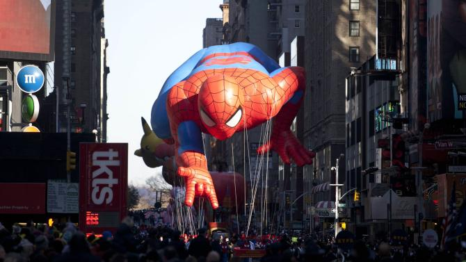 """The """"Spiderman"""" float is seen during the Macy's Thanksgiving Day Parade in Times Square in New York on Thursday, Nov. 24, 2011. The parade premiered in 1924, this is its 85th year. (AP Photo/Andrew Burton)"""