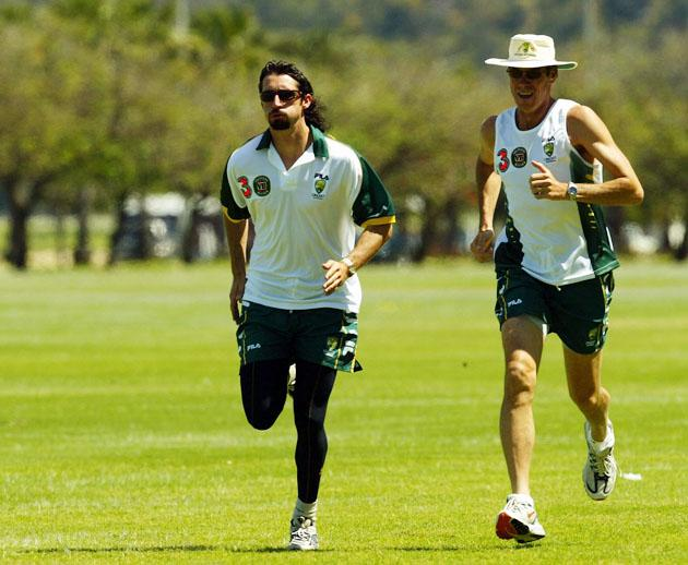 Jason Gillespie of Australia runs with coach John Buchanan