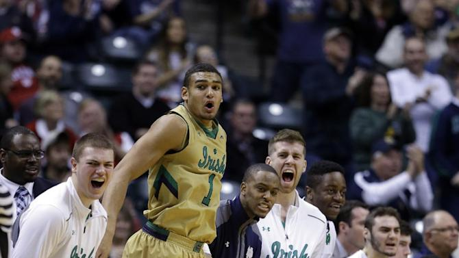 The Notre Dame bench, including Austin Torres (1), reacts to a dunk against Purdue in the second half of an NCAA college basketball game in Indianapolis, Saturday, Dec. 20, 2014. Notre Dame defeated Purdue 94-63. (AP Photo/Michael Conroy)