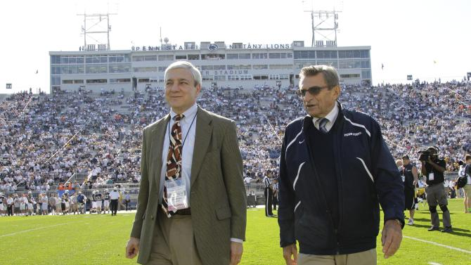 FILE - This Oct. 8, 2011 file photo shows Penn State president Graham Spanier, left, and head football coach Joe Paterno before a college football game against Iowa in State College, Pa. Attorneys for Penn State's ousted president are planning a news conference to rebut what they view as inaccuracies in a school-sanctioned report that concluded he concealed child sex-abuse allegations. Graham Spanier's lawyer tells The Associated Press that the legal team will meet with reporters in Philadelphia early next week. Peter Vaira says there are many errors in the report by former FBI Director Louis Freeh. (AP Photo/Gene Puskar, File)