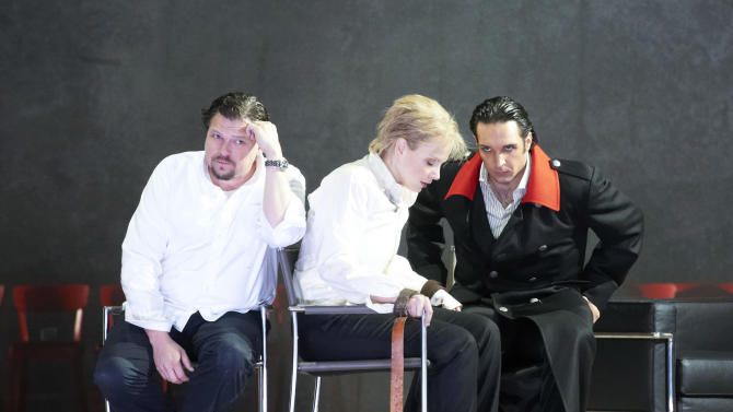 """In this photo taken Monday, May 7, 2012, Michael Schade in the role of Tito, Elina Garanca as Sesto and Adam Plachetka as Publio, from left, perform during a dress rehearsal for the opera """"La Clemenza di Tito"""" by Wolfgang Amadeus Mozart at the State Opera in Vienna, Austria. (AP Photo/Wiener Staatsoper/Michael Poehn)"""