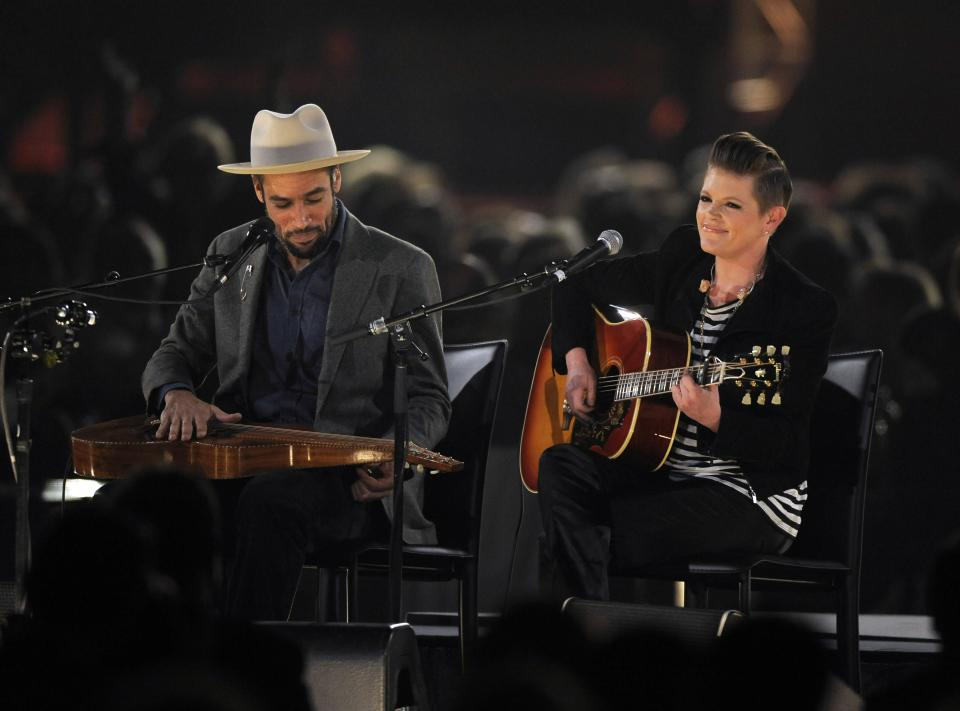 Ben Harper, left, and Natalie Maines perform at the MusiCares Person of the Year tribute honoring Bruce Springsteen at the Los Angeles Convention Center on Friday Feb. 8, 2013, in Los Angeles. (Photo by Chris Pizzello/Invision/AP)