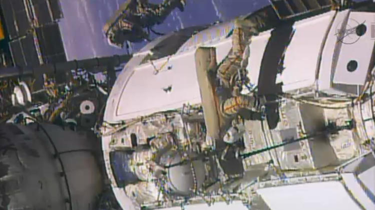 In this frame grab from video provided by NASA, two Russian flight engineers perform maintenance on the International Space Station, Monday, June 24, 2013. The crew includes three Russians, two Americans and one Italian. The Italian and one American will conduct a pair of spacewalks for NASA in July. (AP Photo/NASA)
