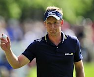 Luke Donald thanks the crowd on the 15th green during the PGA Championship on May 27. &quot;Justin [Rose] has the game to win the US Open,&quot; Donald told reporters after successfully defending Europe&#39;s most prestigious title