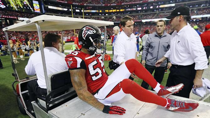 Atlanta Falcons defensive end John Abraham leaves the field on a cart with an apparent left ankle injury during the fourth quarter of an NFL football game against the Tampa Bay Buccaneers in Atlanta, Sunday, Dec. 30, 2012. The Buccaneers won 22-17. (AP Photo/Atlanta Journal-Constitution, Curtis Compton)  MARIETTA DAILY OUT; GWINNETT DAILY POST OUT; LOCAL TV OUT; WXIA-TV OUT; WGCL-TV OUT