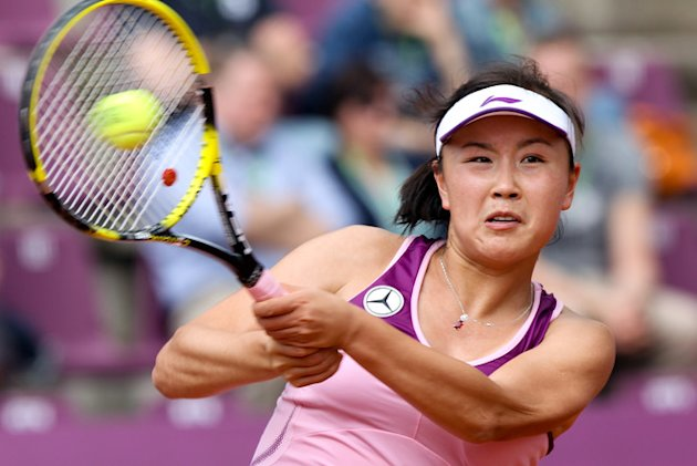 China's Shuai Peng Returns AFP/Getty Images