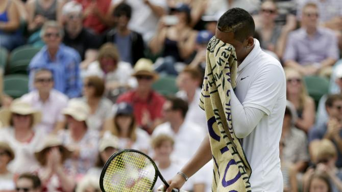 Nick Kyrgios of Australia wipes his face during his match against Richard Gasquet of France at the Wimbledon Tennis Championships in London