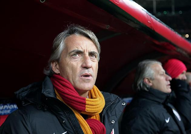 Galatasaray's coach Roberto Mancini watches his team during their Champions League Group B soccer match against Juventus, at the TT Arena Stadium in Istanbul, Turkey, Tuesday, Dec. 10, 2013. (AP P