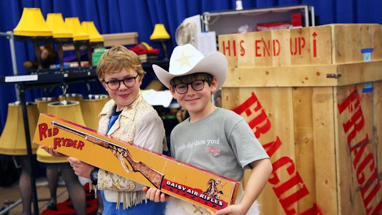 "In this Oct. 26, 2012, photo, Joe West, left, and Johnny Rabe hold a Red Ryder BB Gun, one of the props from ""A Christmas Story, the Musical"" in New York. Both 12-year-old boys are making their Broadway debuts playing Ralphie in the stage adaptation of the cult 1983 film. (AP Photo/Mark Kennedy)"