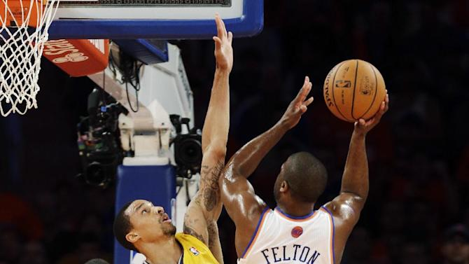 New York Knicks' Raymond Felton (2) is guarded by Indiana Pacers' George Hill as he drives to the basket in the first quarter of Game 1 of their NBA basketball playoff series in the Eastern Conference semifinals at Madison Square Garden in New York, Sunday, May 5, 2013. (AP Photo/Kathy Willens)