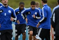 Schalke's Jefferson Farfan (2nd L) and Ibarhim Afellay (3rd L) during a training session on October 2. Schalke were held 2-2 at newly promoted Fortuna Dusseldorf last Friday