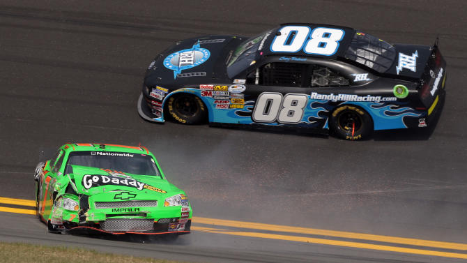 Driver Danica Patrick, left, slides down the track after a crash as Casey Roderick (08) drives past during the NASCAR Drive4COPD 300 Nationwide series auto race in Daytona Beach, Fla., Saturday, Feb. 25, 2012. (AP Photo/Bill Friel)