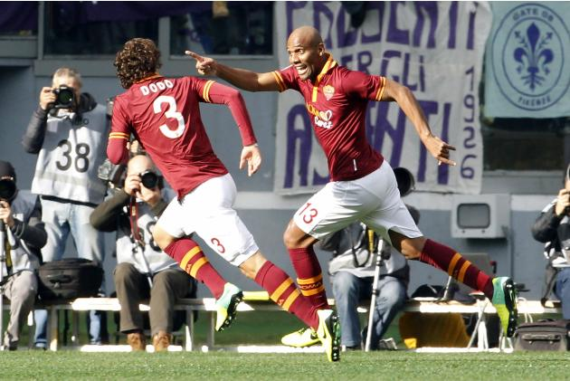 AS Roma's Maicon celebrates with Dodo after scoring against Fiorentina during their Italian Serie A soccer match at the Olympic stadium in Rome