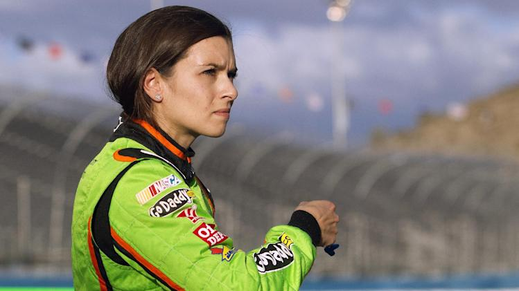Danica Patrick reacts as she looks at a scoreboard displaying her time during qualifying for the NASCAR Sprint Cup Series auto race, Friday, Nov. 9, 2012, at Phoenix International Raceway in Avondale, Ariz. (AP Photo/Paul Connors)