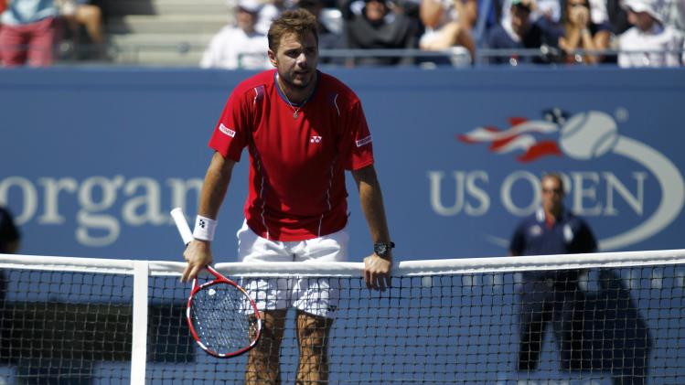 Wawrinka of Switzerland pauses after a missed point against Djokovic of Serbia during their men's semi-final match at the U.S. Open tennis championships in New York