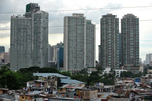 <p>A sprawling shanty-town contrasts with high rise office buildings in the background in Makati, the financial district of Manila, in 2010. The United Nations on Thursday called for a tax on billionaires to help raise more than $400 billion a year for poor countries.</p>
