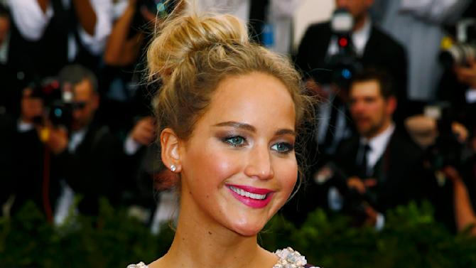 """Actress Jennifer Lawrence arrives at the Metropolitan Museum of Art Costume Institute Gala 2015 celebrating the opening of """"China: Through the Looking Glass,"""" in Manhattan"""