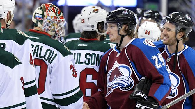 Colorado Avalanche center Nathan MacKinnon (29) greets Minnesota Wild goalie Ilya Bryzgalov (30) of Russia following Game 7 of an NHL hockey first-round playoff series on Wednesday, April 30, 2014, in Denver. Minnesota won 5-4 to win the series