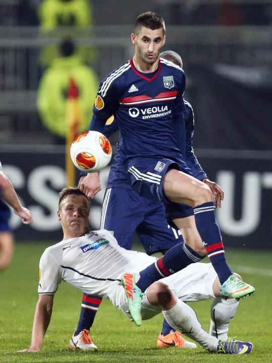 Olympique Lyon's Gonalons challenges Kolar of Viktoria Plzen during their Europa League soccer match at the Gerland stadium in Lyon