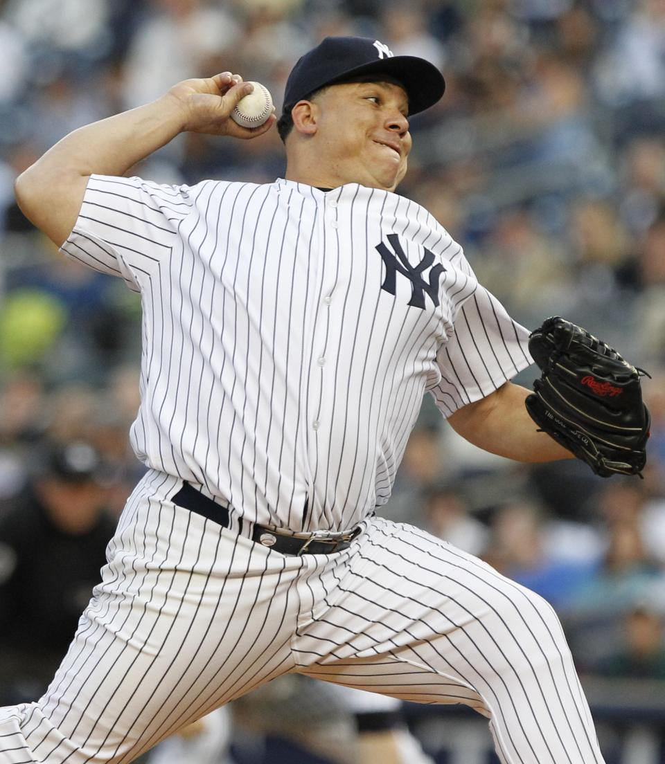 New York Yankees' Bartolo Colon delivers a pitch during the first inning of a baseball game against the Boston Red Sox Friday, May 13, 2011, at Yankee Stadium in New York. (AP Photo/Frank Franklin II)