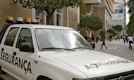 A security van from a private company is seen in front of a shopping mall in Sao Paulo in 2006. A gang of women -- described as blonde, bilingual and well educated -- have been taking Brazilian shopping malls by storm, kidnapping female shoppers and maxing out their credit cards, police say