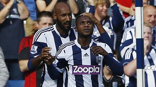 West Bromwich Albion's Stephane Sessegnon (R) celebrates his goal against Sunderland with Nicolas Anelka (Reuters)