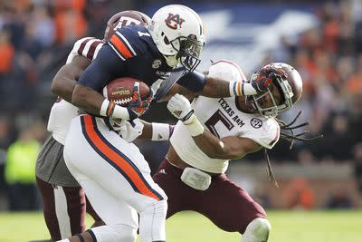 Dismissed Auburn player accused of punching 4 people in a bar after dress code dispute