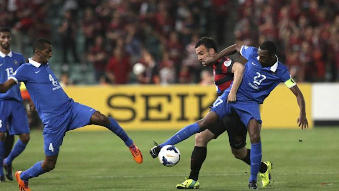 Saudi Arabia's Al Hilal's Saud Kariri, right, and Western Sydney Wanderers' Mark Bridge battle for the ball during their Asian Champions League Final soccer match in Sydney, Australia, Saturday, Oct. 25, 2014. The Wonderers won the match 1-0. (AP Photo/Rob Griffith)