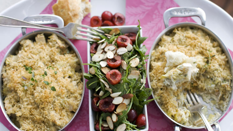 In this image taken on Jan. 21, 2013, crab and hearts of palm gratin with arugula and cherry salad are shown in Concord, N.H. (AP Photo/Matthew Mead)