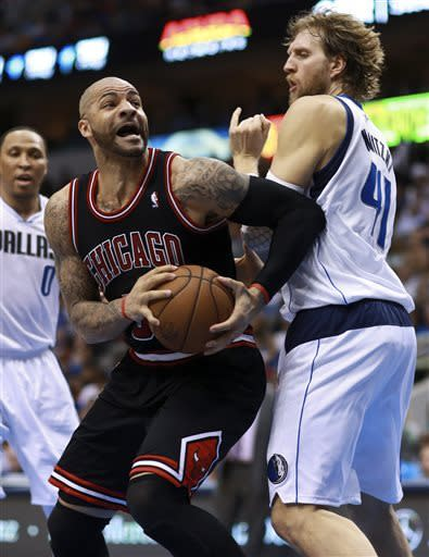 Nowitzki lifts Mavericks past Bulls 100-98