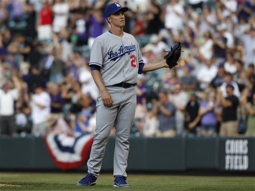 Ramirez lifts Dodgers to 10-8 win over Rockies
