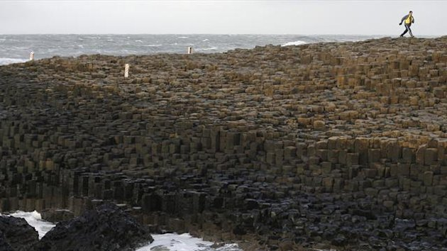 A tourist visits the Giant's Causeway landscape in the northeast coast of Northern Ireland (Reuters)