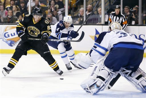 Bruins beat Jets 2-1 in shootout
