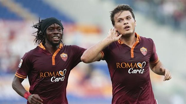 AS Roma's Adem Ljajic (R) celebrates with teammate Kouassi Gervinho after scoring against Verona during their Italian Serie A soccer match at the Olympic stadium in Rome September 1, 2013 (Reuters)