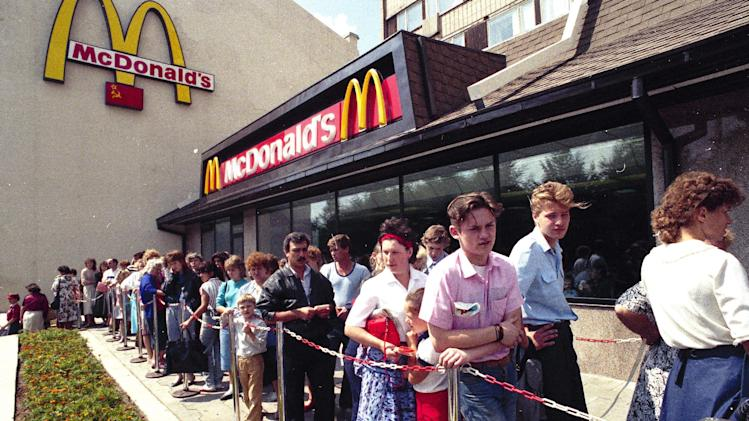 FILE - In this file photo taken in 1991, Russians wait in line outside a McDonald's fast food restaurant in Moscow. Russian news agencies reported Thursday, Aug. 21, 2014, that the country's food safety agency will conduct checks on McDonald's restaurants in the Urals following food safety complaints, a day after four branches of the chain were shuttered in Moscow. (AP Photo)
