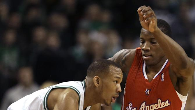 Boston Celtics guard Avery Bradley (0), left, tries to drive past Los Angeles Clippers guard Eric Bledsoe (12), right, in the first quarter of an NBA basketball game at the TD Garden in Boston, Sunday, Feb. 3, 2013. (AP Photo/Steven Senne)