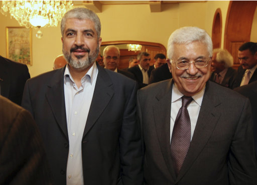 FILE - In this photo provided Nov. 24, 2011 by the office of Khaled Meshaal, Palestinian Hamas leader Khaled Mashaal, left, and Palestinian President Mahmoud Abbas are seen together during their meeting in Cairo, Egypt. Efforts to reunify the Palestinians behind one leadership appear to hit a dead end: Hamas leaders in Gaza, the territory the Islamic militant movement has ruled since a violent 2007 takeover, have concluded that subordinating themselves to the Palestinian Authority would waste a golden opportunity offered by the Arab Spring and the rise of political Islam in the region. (AP Photo/Office of Khaled Meshaal, File)