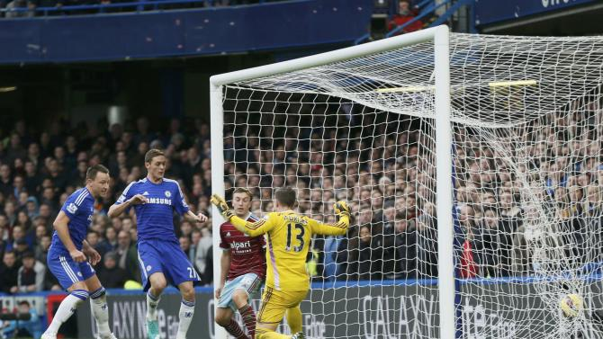 Chelsea's John Terry scores a goal against West Ham United during their English Premier League soccer match at Stamford Bridge in London