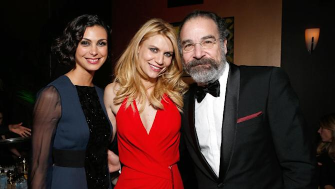 IMAGE DISTRIBUTED FOR FOX SEARCHLIGHT - From left, Morena Baccarin, Claire Danes, and Mandy Patinkin attend the Fox Golden Globes Party on Sunday, January 13, 2013, in Beverly Hills, Calif. (Photo by Todd Williamson/Invision for Fox Searchlight/AP Images)