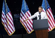 US President Barack Obama speaks during a campaign concert at the Nokia Theater, on October 7, in Los Angeles. Obama is on a three-day trip where he will campaign in California and Ohio as well as attend the establishment of the Cesar Chavez National Monument