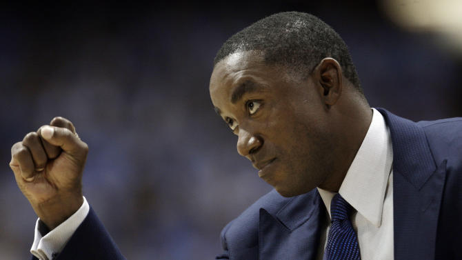 FILE - In this Nov. 9, 2009, file photo, Florida International coach Isiah Thomas directs his team during the first half of an NCAA college basketball game against North Carolina in Chapel Hill, N.C. Thomas tells the story like this: Given the chance to leave Florida International and take a consulting job with the New York Knicks this summer, he made the decision to stay with the Panthers.  Hours later, in New York, the story differs a bit: Thomas still wants the Knicks job. If this was happening in the offseason, that's one thing. But this latest twist to the many sagas of Thomas came just last week, with his FIU team days away from opening its second season under the Hall of Fame player. (AP Photo/Gerry Broome, File)