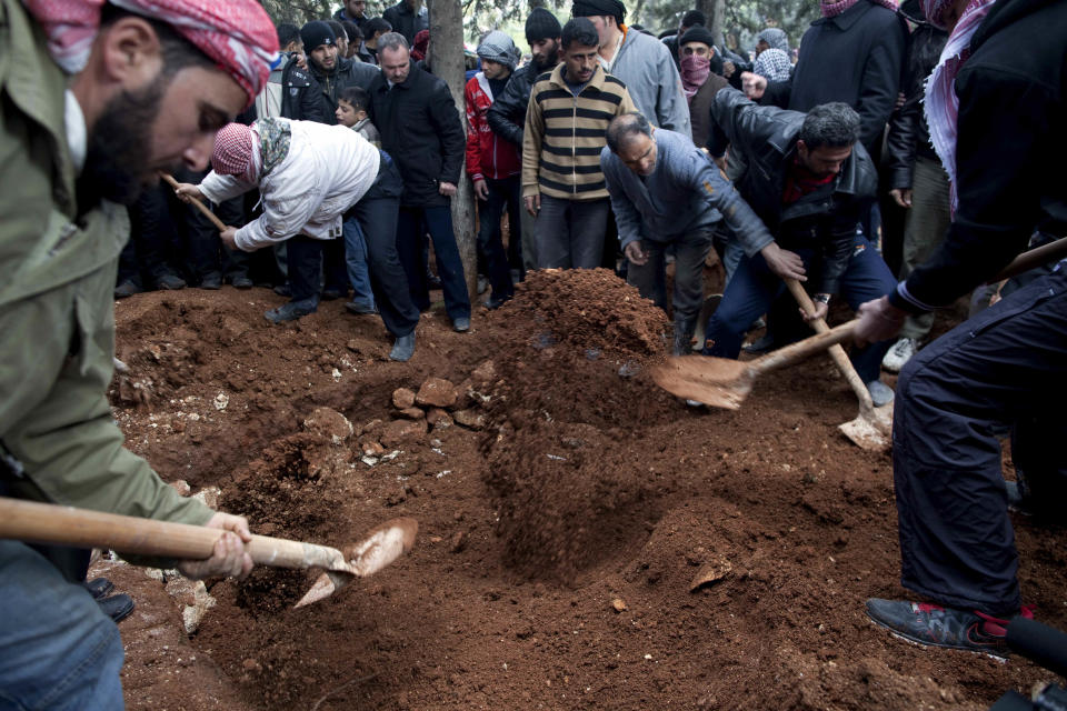 Men bury three Free Syrian Army fighters allegedly killed by the Syrian Army during their funeral in Idlib, north Syria, Saturday, March 3, 2012. (AP Photo/Rodrigo Abd)