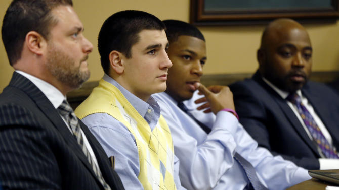 From left, Defense attorney Adam Nemann, his client, defendant Trent Mays, 17, defendant 16-year-old Ma'lik Richmond and his attorney, Walter Madison, listen to testimony during Mays and Richmond's trial on rape charges in juvenile court on Thursday, March 14, 2013 in Steubenville, Ohio. Mays and Richmond are accused of raping a 16-year-old West Virginia girl in August of 2012. (AP Photo/Keith Srakocic, Pool)