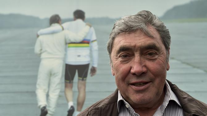Eddy Merckx poses for a photo  at the entrance of an exhibition celebrating Eddy Merckx and Jacky Icks in Brussels, Belgium