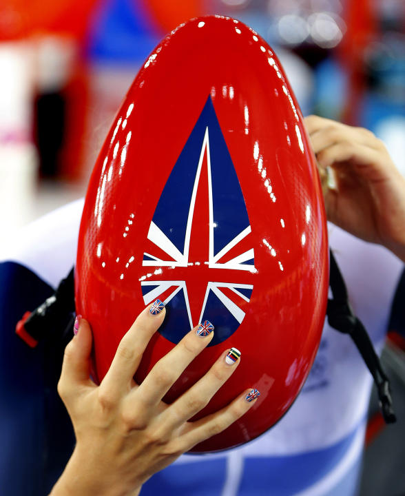 The Union Flag and the rainbow stripes of a world champion cyclist are painted on the fingernails of Britain's Laura Trott ahead of her women's track cycling ominium 3km individual pursuit race at the