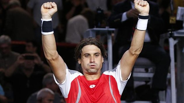 David Ferrer of Spain celebrates after winning his semi-final men&#39;s singles match against Michael Llodra of France at the Paris Masters