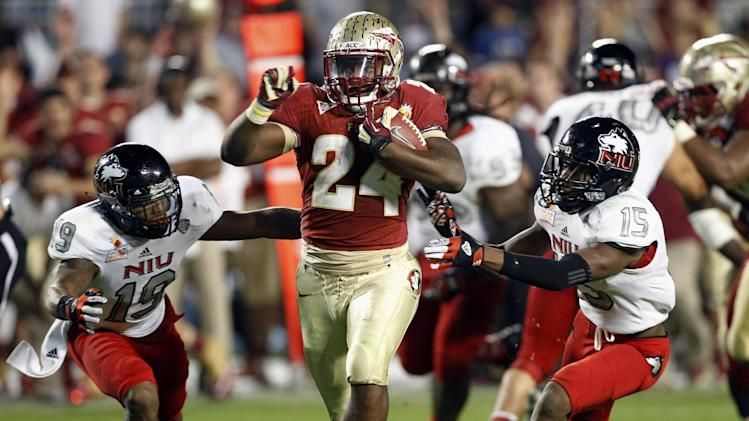 Northern Illinois cornerback Demetrius Stone (19) and defensive back Jimmie Ward (15) can't hold onto Florida State fullback Lonnie Pryor (24) on his way to a touchdown during the second half of the Orange Bowl NCAA college football game, Tuesday, Jan 1, 2013, in Miami. (AP Photo/Alan Diaz)