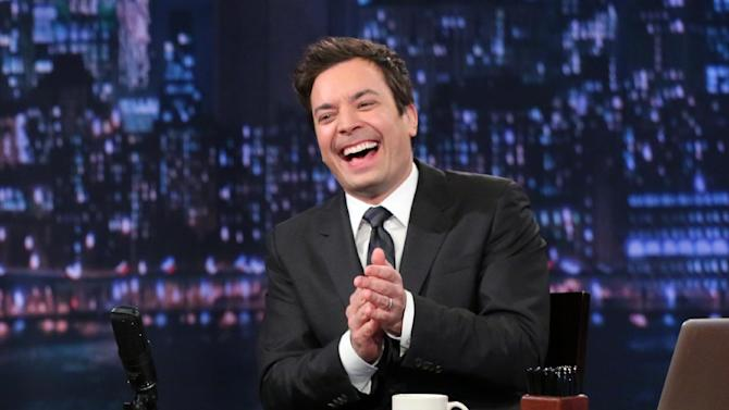 """This Feb. 21, 2013 photo released by NBC shows Jimmy Fallon, host of """"Late Night with Jimmy Fallon,"""" on the set in New York. Speculation is swirling the network is taking steps to replace the host with Jimmy Fallon next year and move the show from Burbank to New York.  NBC confirmed Wednesday, March 20, it's creating a new studio for Fallon in New York, where he hosts """"Late Night."""" But the network did not comment on a report that the digs at its Rockefeller Plaza headquarters may become home to a transplanted, Fallon-hosted """"Tonight Show.""""  (AP Photo/NBC, Lloyd Bishop)"""