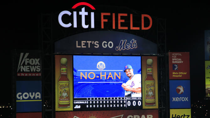 A graphic displays New York Mets' Johan Santana on an outfield video screen after he pitched the first no-hitter in Mets' history in a baseball game against the St. Louis Cardinals, Friday, June 1, 2012 in New York. Helped by an umpire's missed call and an outstanding catch in left field, the Mets defeated the Cardinals 8-0. (AP Photo/Mark Lennihan)